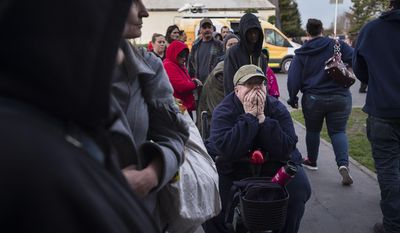 Paula Gillock, 53, waits in line for breakfast at the Silver Dollar Fairgrounds on Monday, Feb. 13, 2017, in Chico, Calif. She left her home in Gridley and slept in her car with her cat Mimi after residents were evacuated from the area due to fears of a possible failure of the emergency spillway at the Oroville Dam.(Paul Kitagaki Jr./The Sacramento Bee via AP)