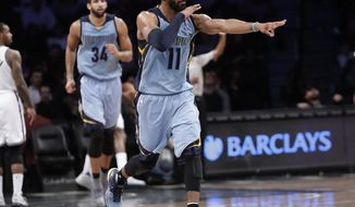 Memphis Grizzlies' Mike Conley (11) reacts after making a three point basket as during the second half of an NBA basketball game against the Brooklyn Nets Monday, Feb. 13, 2017, in New York. The Grizzlies won 112-103. (AP Photo/Frank Franklin II)