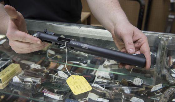 In this file photo taken Jan. 31, 2017, a silencer is displayed at Ed's Public Safety gun shop in Stockbridge, Ga. (AP Photo/Lisa Marie Pane) ** FILE **