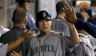 FILE - This Aug. 25, 2016 file photo shows Seattle Mariners' Adam Lind celebrating with teammates after scoring on a single during the sixth inning of a baseball game against the Chicago White Sox in Chicago. A person familiar with the deal says that the Washington Nationals have agreed to a $1.5 million, one-year deal with free-agent first baseman Adam Lind, pending a physical. The person confirmed the agreement to The Associated Press on condition of anonymity on Monday, Feb. 13, 2016 because nothing had been announced by the Nationals. (AP Photo/Nam Y. Huh, file)