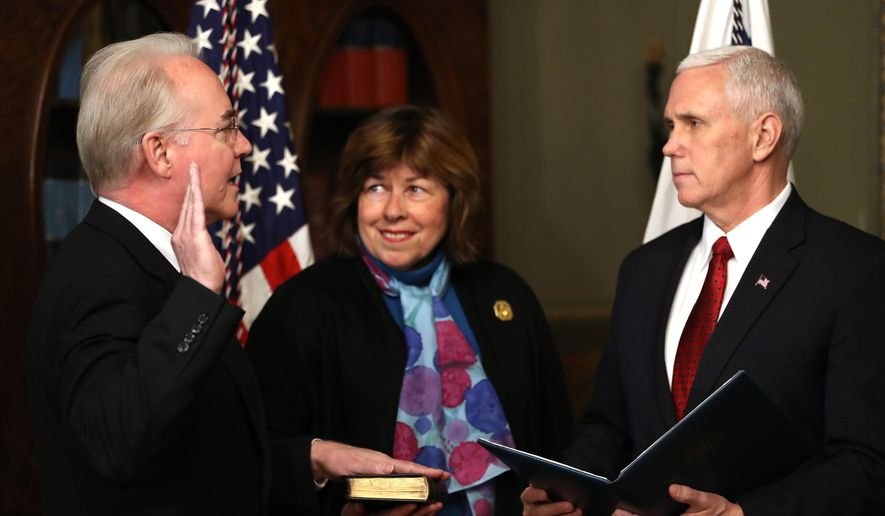 Vice President Mike Pence administers the oath of office to Health and Human Services Secretary Tom Price, accompanied by his wife Betty, Friday, Feb. 10, 2017,  in the in the Eisenhower Executive Office Building on the White House complex in Washington. (AP Photo/Andrew Harnik)