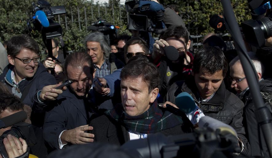 FILE - In this Jan. 28, 2013 file photo, Doctor Eufemiano Fuentes, centre, implicated in the Operation Puerto doping scandal leaves a court house surrounded by media in Madrid, Spain. A political impasse in Spain and the failure to reach a deal with football's governing bodies have hurt efforts to maintain doping tests in the Spanish league with only 57 doping tests have been carried out in Spain's first division this season, according to the country's anti-doping agency, while more than 400 players have seen action in over 200 matches so far. (AP Photo/Andres Kudacki, File)