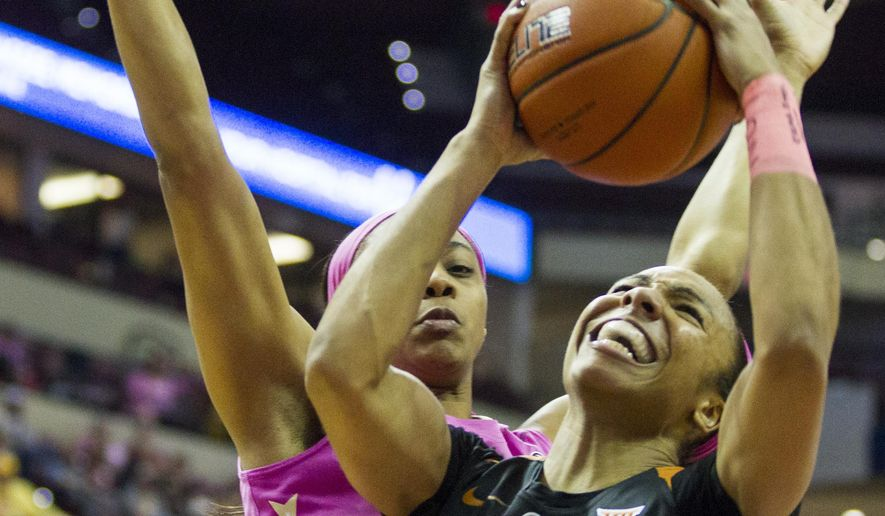 Texas guard Brianna Taylor is fouled by Florida State forward Ivey Slaughter in the first half of an NCAA college basketball game in Tallahassee, Fla., Monday, Feb. 13, 2017. (AP Photo/Mark Wallheiser)