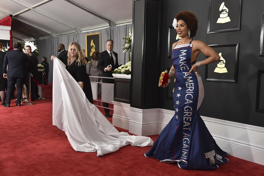 """Joy Villa wears a gown that says """"Make America Great Again"""" at the 59th annual Grammy Awards at the Staples Center on Sunday, Feb. 12, 2017, in Los Angeles. (Photo by Jordan Strauss/Invision/AP)"""