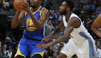 Golden State Warriors forward Kevin Durant, left, goes up for a shot as Denver Nuggets guard Will Barton defends in the first half of an NBA basketball game, Monday, Feb. 13, 201, in Denver. (AP Photo/David Zalubowski)