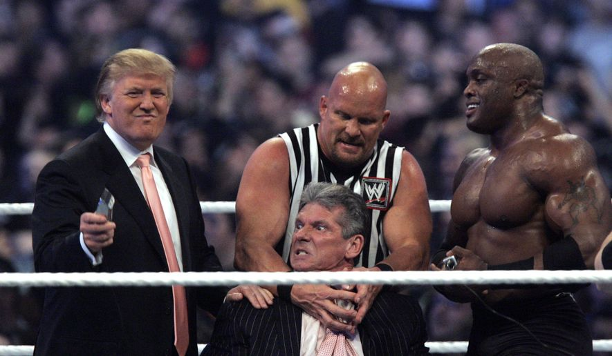 "WWE Chairman Vince McMahon, center, held by ""Stone Cold"" Steve Austin, prepares to have his hair cut off by Donald Trump, left, and Bobby Lashley, right, after Lashley defeated Umaga at Wrestlemania 23 at Ford Field in Detroit, Sunday, April 1, 2007. (AP Photo/Carlos Osorio)"