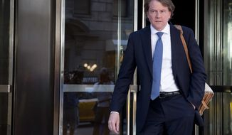 Attorney Donald McGahn leaves the Four Seasons hotel in New York, Thursday, June 9, 2016, after a GOP fundraiser. (AP Photo/Mary Altaffer)