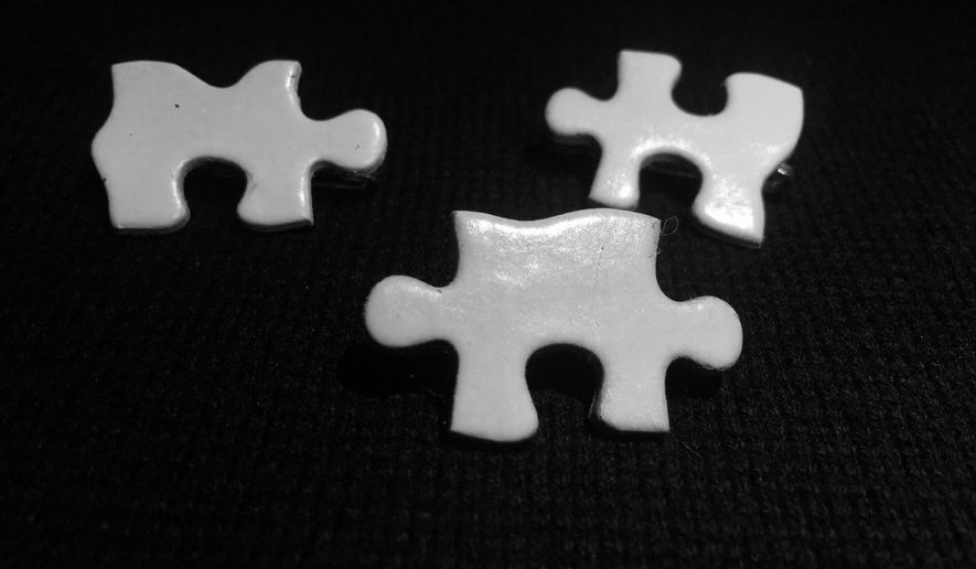 A group of students at Elizabethtown College, a predominantly white small liberal arts college in Pennsylvania, will wear white pins shaped like puzzle pieces for one month in order to remind themselves of their white privilege. (Elizabethtown College Democrats via Twitter)