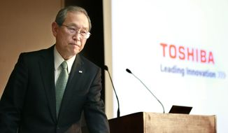 Toshiba Corp. President Satoshi Tsunakawa leaves after his speech during a press conference at the company's headquarters in Tokyo, Tuesday, Feb. 14, 2017. (AP Photo/Shizuo Kambayashi)