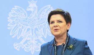 In this Feb. 7, 2017 Polish Prime Minister Beata Szydlo speaks during a press conference in Warsaw, Poland. Polish prosecutors filed charges Tuesday, Feb. 14, 2017 against a 21-year-old man who is accused of causing a traffic accident that injured Szydlo and two other people last week. (AP Photo/Alik Keplicz)