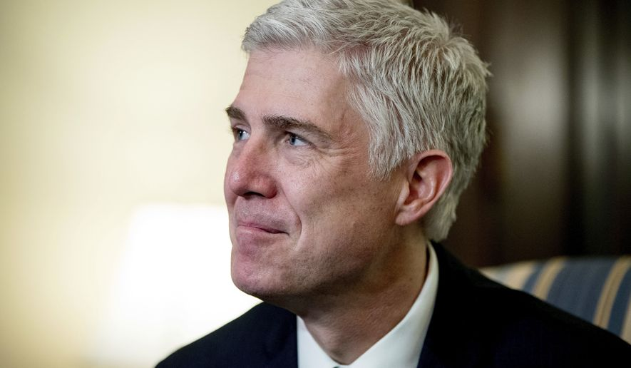 Supreme Court Justice nominee Neil Gorsuch meets with Sen. Chris Coons, D-Del. on Capitol Hill in Washington, Tuesday, Feb. 14, 2017. (AP Photo/Andrew Harnik) ** FILE **
