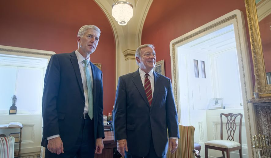 Supreme Court Justice nominee Judge Neil Gorsuch meets with Senate Minority Whip Richard Durbin of Ill. on Capitol Hill in Washington, Tuesday, Feb. 14, 2017. (AP Photo/J. Scott Applewhite)
