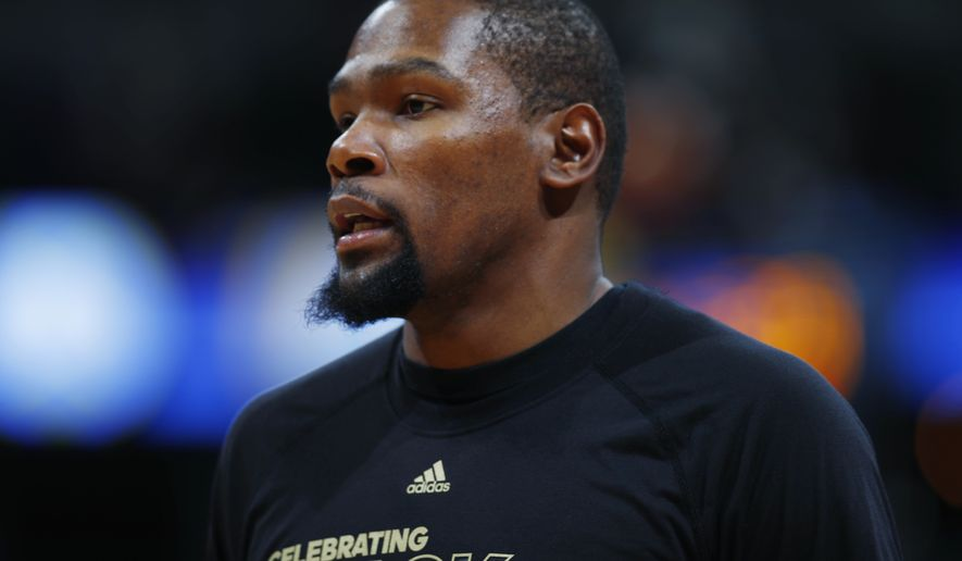 Golden State Warriors forward Kevin Durant (35) in the first half of an NBA basketball game Monday, Feb. 13, 201, in Denver. (AP Photo/David Zalubowski)