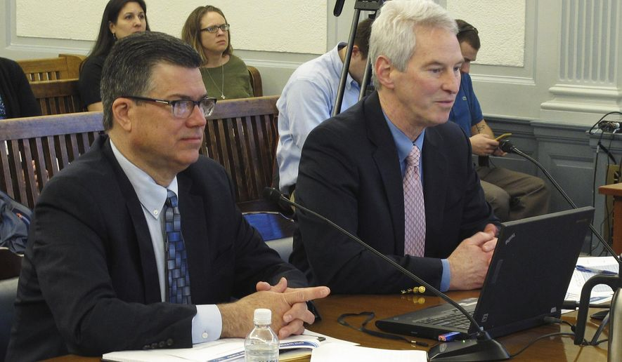 Keith Meyer, left, president of the Alaska Gasline Development Corp., and Frank Richards, a senior vice president with the corporation, appear before the Senate Finance Committee on Tuesday, Feb. 14, 2017, in Juneau, Alaska. The state-sponsored corporation is pursuing a major gas project. (AP Photo/Becky Bohrer)