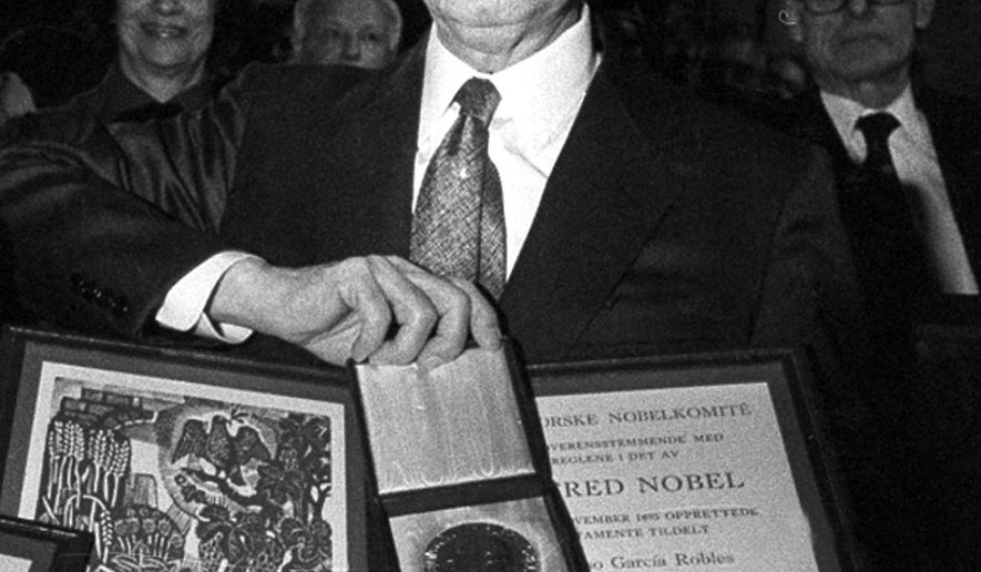 FILE - In this Dec. 10, 1982 file photo, co-winner of the 1982 Nobel Peace Prize, Alfonso Garcia Robles, of Mexico, poses with his Nobel prize diploma and medal in Oslo, Norway, awarded for his work on behalf of nuclear disarmament. The Nobel Peace Prize medal awarded to the Mexican diplomat and nuclear disarmament expert will be auctioned in April 2017. Christie's in New York made the announcement on Tuesday, Feb. 14, the 50th anniversary of the signing of a treaty that created a nuclear-free zone in Latin America and the Caribbean. (AP Photo/Jens O. Kvale, File)
