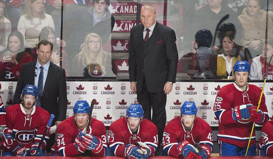 Montreal Canadiens coach Michel Therrien watches from the behind the bench during the closing moments of the team's NHL hockey game against the St. Louis Blues on Saturday, Feb. 11, 2017, in Montreal. (Graham Hughes/The Canadian Press via AP)