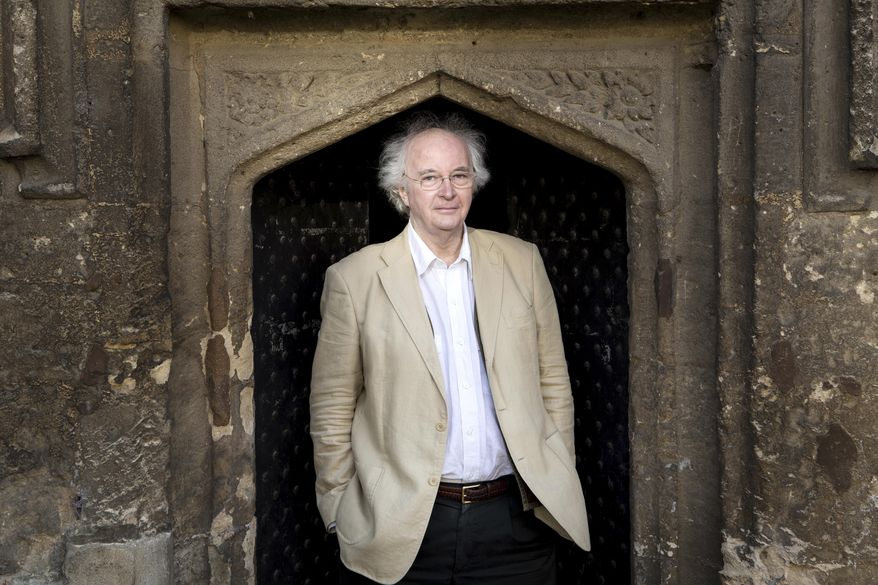 "In this Jan. 11, 2017 photo provide by Penguin Random House, author Philip Pullman poses for a photograph outside of Worcester College, in Oxford, England. The irrepressible young heroine of Pullman's fantasy saga ""His Dark Materials"" returns in a new novel being published in Britain and the U.S. on Oct. 19, the first part of a trilogy called ""The Book of Dust."" (Michael Leckie/Penguin Random House via AP)"