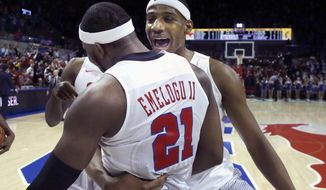SMU guard Ben Emelogu II (21) is hugged by teammate Jarrey Foster, right, after an NCAA college basketball game against Cincinnati in Dallas, Sunday, Feb. 12, 2017. (AP Photo/LM Otero)
