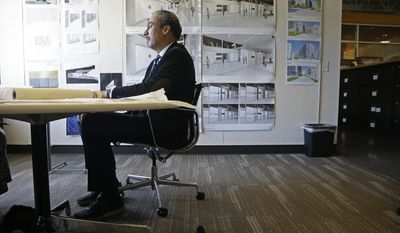 In this Wednesday, Jan. 18, 2017, photo, architect Phil Freelon listens to a question during an interview at his office in Durham, N.C. For Freelon, the National Museum of African American History and Culture was a crowning triumph, yet its opening last year came amid a wrenching personal trial. His monumental achievement came on the heels of a diagnosis of ALS, a degenerative neurological disease that eventually leads to total paralysis. (AP Photo/Gerry Broome)