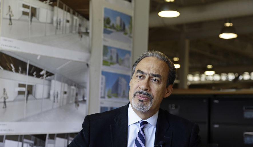 In this Wednesday, Jan. 18, 2017, photo, architect Phil Freelon responds to a question during an interview at his office in Durham, N.C. For Freelon, the National Museum of African American History and Culture was a crowning triumph, yet its opening last year came amid a wrenching personal trial. His monumental achievement came on the heels of a diagnosis of ALS, a degenerative neurological disease that eventually leads to total paralysis. (AP Photo/Gerry Broome)