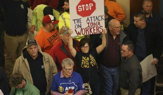 People gather in the Iowa Capitol for a public hearing on proposed changes to the state's collective bargaining law on Monday, Feb. 13, 2017, in Des Moines, Iowa. (Kelsey Kremer/The Des Moines Register via AP)