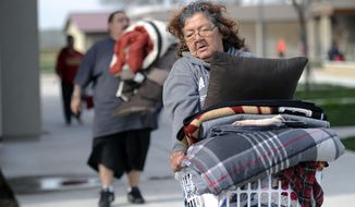 Rose Leal and her family leave an emergency shelter at the Sutter High School gymnasium to take showers on Monday, Feb. 13, 2017, in Sutter, Calif. The thousands of people who were ordered to leave their homes after a damaged California spillway threatened to unleash a 30-foot wall of water may not be able to return until significant erosion is repaired, authorities said Monday. (Chris Kaufman/The Appeal-Democrat via AP)