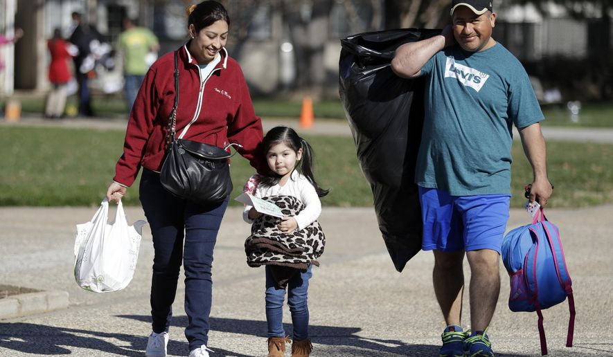 Catalina Rosales, from left, her daughter Kelly, 3, and husband Armando, of Gridley, Calif., leave a shelter after a mandatory evacuation was lifted Tuesday, Feb. 14, 2017, in Chico, Calif. Authorities lifted an evacuation order Tuesday for thousands of California residents who live below the nation's tallest dam after declaring that the risk of catastrophic collapse of a damaged spillway had been significantly reduced. (AP Photo/Marcio Jose Sanchez)