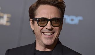 """FILE - This Oct. 20, 2016 file photo shows Robert Downey Jr. at the Los Angeles premiere of """"Doctor Strange."""" Downey Jr. and Richard Linklater are teaming up to make a film adapted from a podcast.Megan Ellison's Annapurna Pictures announced Monday, Feb. 13, 2017, that it will produce the untitled film, with Linklater directing and Downey Jr. starring. (Photo by Jordan Strauss/Invision/AP, File)"""
