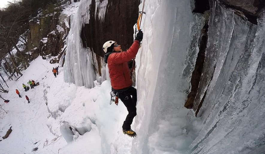 """In this Sunday, Feb. 6, 2017 photo, Chuck Monjak, of Dedham, Mass., climbs """"Chia,"""" an ice formation on Frankenstein Cliff in Hart's Location, N.H. """"It's definitely terrifying on some level. I think that's why a lot of us do it because of the adrenaline rush, like riding a motorcycle around with a track at 100 miles an hour or jumping out of an airplane or all the other """"extreme' things people do,"""" Monjak said. (AP Photo/Robert F. Bukaty)"""