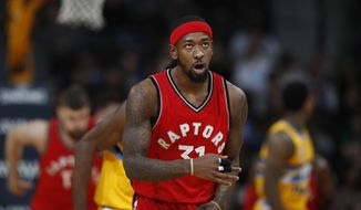 This Nov. 18, 2016 photo shows Toronto Raptors forward Terrence Ross (31) in the second half of an NBA basketball game in Denver. The Raptors acquired veteran power forward Serge Ibaka from Orlando on Tuesday, Feb. 14, 2017 for Terrence Ross and a 2017 first round draft pick. (AP Photo/David Zalubowski)