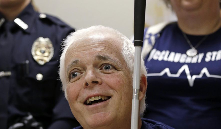 Mount Vernon police officer Michael McClaughry smiles during a news conference shortly before his discharge Tuesday, Feb. 14, 2017, at Harborview Medical Center in Seattle. McClaughry was blinded when shot while on duty nearly two months earlier and was discharged from the hospital on Valentine's Day, his 39th wedding anniversary. (AP Photo/Elaine Thompson)