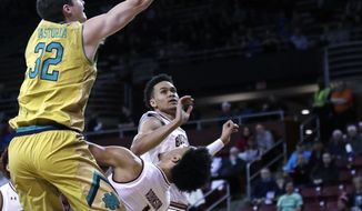 Notre Dame guard Steve Vasturia (32) is fouled by Boston College guard Jerome Robinson (1) on a drive to the basket during the first half of an NCAA basketball game in Boston, Tuesday, Feb. 14, 2017. (AP Photo/Charles Krupa)