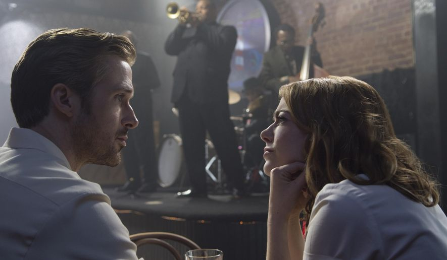 """This image released by Lionsgate shows Ryan Gosling, left, and Emma Stone in a scene from, """"La La Land.""""  The film was nominated for an Oscar for best feature film. The 89th Academy Awards will take place on Feb. 26.  (Dale Robinette/Lionsgate via AP)"""