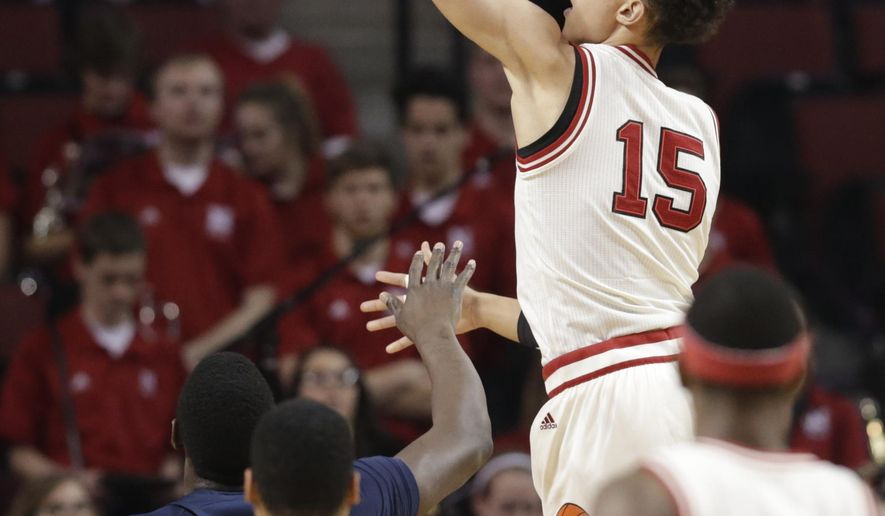 Nebraska's Isaiah Roby (15) dunks over Penn State's Shep Garner (33) during the first half of an NCAA college basketball game in Lincoln, Neb., Tuesday, Feb. 14, 2017. (AP Photo/Nati Harnik)