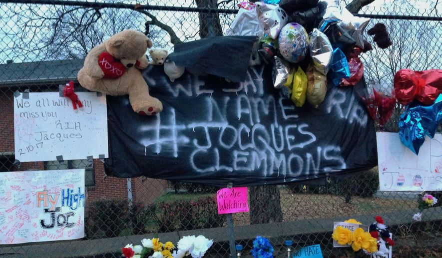 A memorial is seen set up in a neighborhood where near where Nashville Officer Josh Lippert on Friday shot Jocques Scott Clemmons in a Nashville, Tenn., Tuesday, Feb. 14, 2017. Clemmons died at the hospital Friday. Newly obtained surveillance video has caused Nashville police to revise their account of a traffic stop on Friday that ended with the white officer shooting and killing an armed African-American man. (AP Photo/Jonathan Mattise)