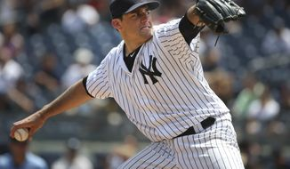 FILE - In this Sunday, July 24, 2016, file photo, New York Yankees starting pitcher Nathan Eovaldi throws during the first inning of the baseball game against the San Francisco Giants at Yankee Stadium in New York. The Tampa Bay Rays have finalized a $2 million, one-year contract with injured pitcher Nathan Eovaldi.The 27-year-old right-hander is expected to miss the 2017 season while recovering from Tommy John surgery last August, when he was with the New York Yankees. (AP Photo/Seth Wenig, File)