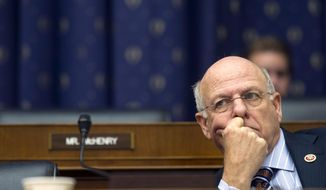 """FILE - In this Feb. 11, 2014, file photo. House Financial Services Committee member Rep. Steve Pearce, R-N.M., listens on Capitol Hill in Washington. New Mexico's only Republican in its congressional delegation has not scheduled any traditional town hall meetings amid angry scenes nationally. Pearce is asking constituents to sign up for a """"telephone town hall"""" on Wednesday, Feb. 15, as activists vow to attend GOP congressmen's town halls across the country. (AP Photo/Cliff Owen, File)"""