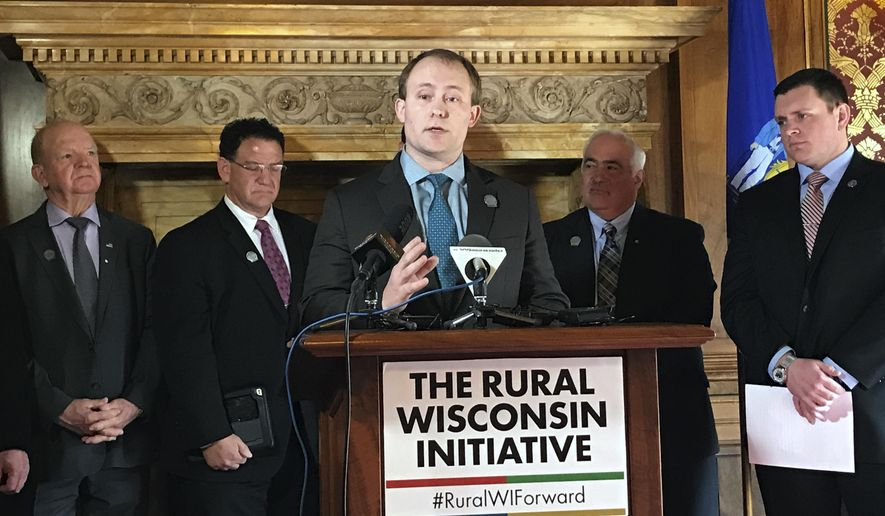 Wisconsin state Rep. Ron Tusler, of Harrison, speaks at a Rural Wisconsin Initiative news conference Tuesday in Madison, Wis. Members of the group presented their plans for improving life in rural Wisconsin and retaining young people who are choosing big cities over small towns. (AP Photo/Cara Lombardo)