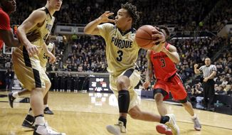 Purdue guard Carsen Edwards (3) drives in front of Rutgers guard Corey Sanders, right, during the second half of an NCAA college basketball game in West Lafayette, Ind., Tuesday, Feb. 14, 2017. Purdue defeated Rutgers 74-55. (AP Photo/Michael Conroy)