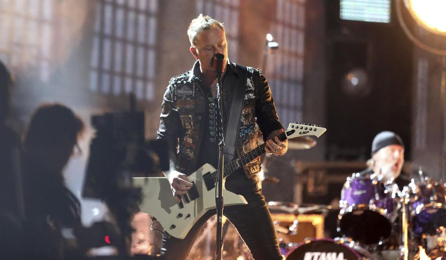 """James Hetfield of """"Metallica"""" performs """"Moth Into Flame"""" at the 59th annual Grammy Awards on Sunday, Feb. 12, 2017, in Los Angeles. (Photo by Matt Sayles/Invision/AP)"""