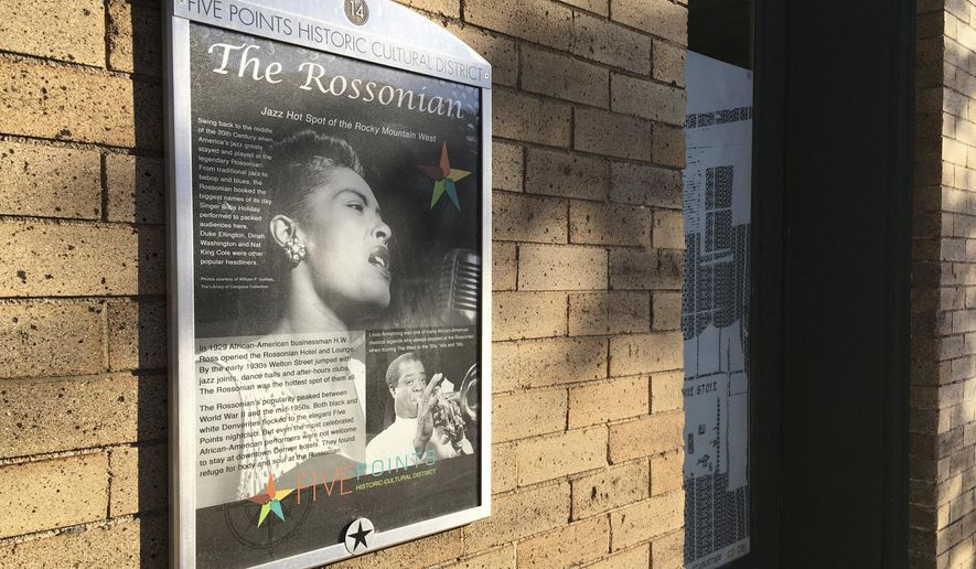 """In this Sept. 17, 2016 photo, a monument to the now closed jazz club at the Rossonian Hotel informs visitors of the once celebrated spot in Denver's Five Points neighborhood that played host to Billie Holiday and Louis Armstrong in Denver, Colo. The neighborhood is where Count Basie and Miles Davis also performed and novelist Jack Kerouac wrote part of """"On The Road."""" The historic black neighborhood is facing gentrification with new breweries and coffee shops near buildings that once housed jazz clubs and consequential black-owned businesses. (AP Photo/Russell Contreras)"""