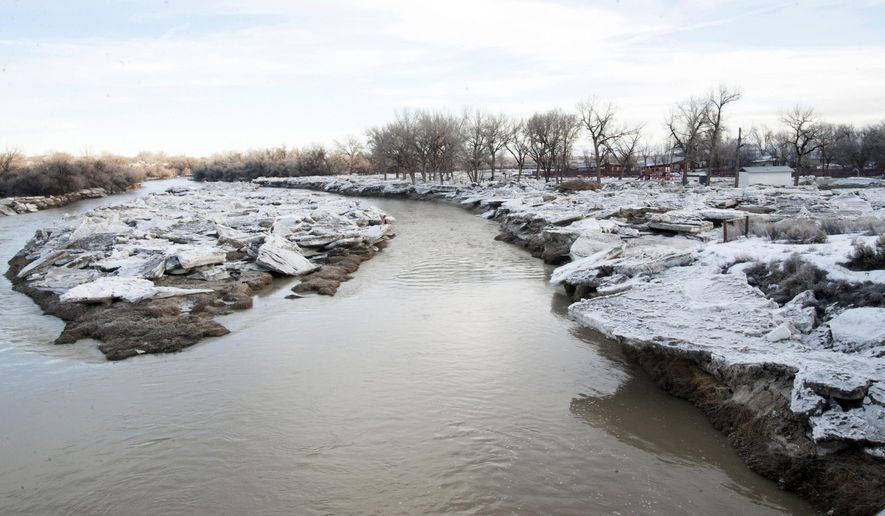 Ice that began to break up overnight shows the clearing on the Bighorn river on Tuesday, Feb. 14, 2017, near Worland, Wyo. The ice jam that caused flooding over the weekend at Worland has broken up and the Bighorn River is back within its banks. Washakie County spokeswoman Kami Neighbors says the ice jam broke up late Monday, and crews are working to clear large pieces of ice left behind in town. (Karla Pomeroy/Northern Wyoming Daily News via AP)