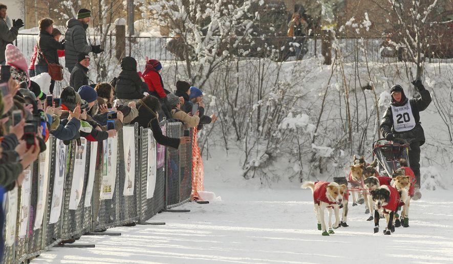 Matt Hall drives his team down the finish chute as he wins the 2017 Yukon Quest International Sled Dog Race Tuesday, Feb. 14, 2017 in Fairbanks, Alaska. The 1,000 race began in Whitehorse, Yukon, Canada just over 10 days ago. (Eric Engman/Fairbanks Daily News-Miner via AP)
