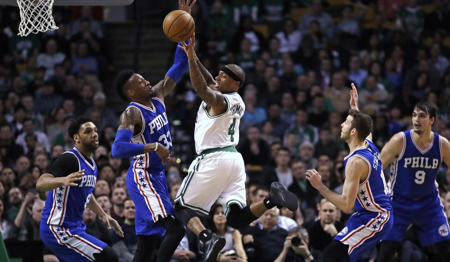 Boston Celtics guard Isaiah Thomas (4) passes the ball as he is covered by the Philadelphia 76ers during the second half of an NBA basketball game in Boston, Wednesday, Feb. 15, 2017. The Celtics defeated the 76ers 116-108. (AP Photo/Charles Krupa)