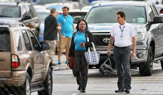 Boeing employees leave work during a shift change on Wednesday, Feb. 15, 2017, in North Charleston, S.C. Thousands of production workers at Boeing's South Carolina plant are deciding whether they want to unionize, writing the next chapter in efforts to organize labor in large manufacturing plants across the South. The first round of voting began early Wednesday. (Wade Spees/The Post And Courier via AP)