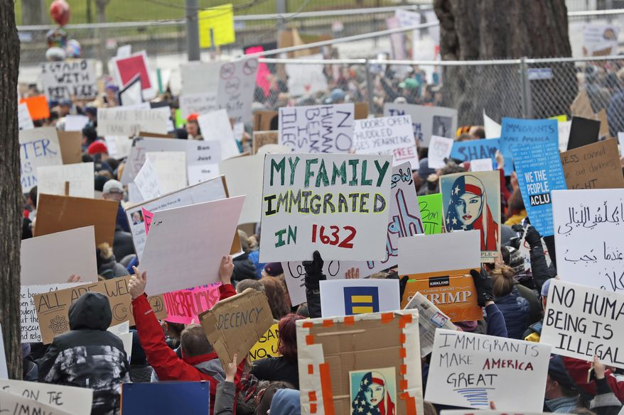 In this Jan. 28, 2017 file photo, protesters carry signs and chant in Lafayette Park near the White House in Washington during a demonstration to denounce President Donald Trump's executive order that bars citizens of seven predominantly Muslim-majority countries from entering the U.S. The number of anti-Muslim hate groups in the U.S. is exploding behind well-paid ideologues, radical Islamic attacks and the incendiary rhetoric of last years presidential campaign, the Southern Poverty Law Center said Wednesday in a new report. (AP Photo/Alex Brandon, File)