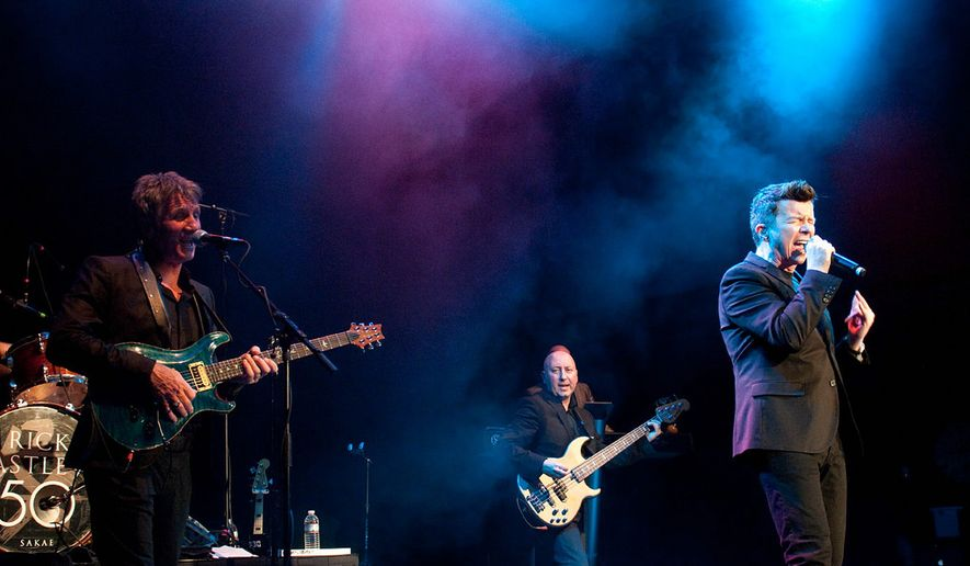 Rick Astley (right) performs with his band at the 9:30 Club Tuesday.  (Erica Bruce)