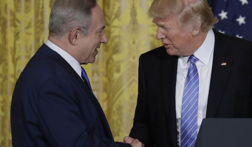 President Donald Trump and Israeli Prime Minister Benjamin Netanyahu shake hands during their joint news conference in the East Room of the White House in Washington, Wednesday, Feb. 15, 2017. (AP Photo/Evan Vucci)
