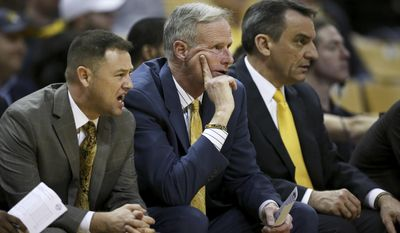From left, Missouri assistant coach Rob Fulford, head coach Kim Anderson and assistant coach Steve Shields watch from the bench during the second half of an NCAA college basketball game against Alabama on Wednesday, Feb. 15, 2017, in Columbia, Mo. (Timothy Tai/Columbia Daily Tribune via AP)/Columbia Daily Tribune via AP)
