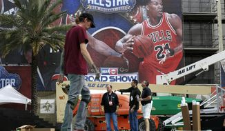 Scott Lokker, left, David Husney, right, Billy Proctor, second right and Scott Cockerill work during the setup of fan participation events in preparation for the NBA All-Star Game festivities this weekend, in New Orleans, Tuesday, Feb. 14, 2017. Charlotte won't be a ghost town this weekend, but it sure won't be buzzing like many had hoped when the NBA awarded the city the 2017 All-Star game. The league moved the event last summer after North Carolina politicians failed to repeal House Bill 2, a law that passed last March that limits the protections of LGBT people. (AP Photo/Gerald Herbert)